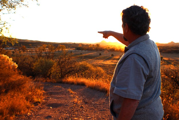 Gary Nabhan points to the Native Seeds/SEARCH Conservation Farm in the distance. - HEATHER HOCH