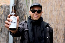 Timothy Johnson makes each bottle of Curly Wolf Kombucha by hand. - HEATHER HOCH