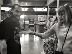 Sherman Ramsey, Satan's Little Helper and customer Debbie at Circle K. - BRIAN SMITH