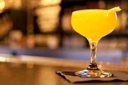 Turmeric turns this cocktail bright yellow. - HEATHER HOCH