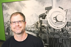 Brian Warde in front of Joe Pagac's painting of the Tucson 420 train at the new Prime Leaf - HECTOR ACUNA