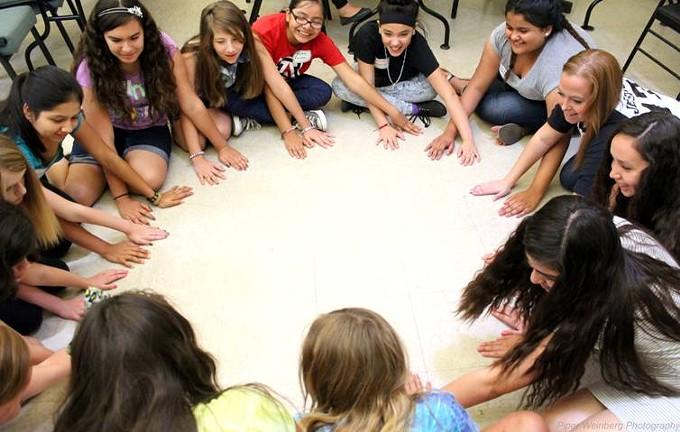 Girls take part in teen pregnancy prevention programs.