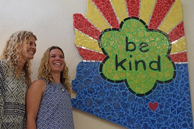 Ben's Bells founder Jeannette Maré and art project manager Colleen Conlin unveil the new mosaic in Tucson City Hall.
