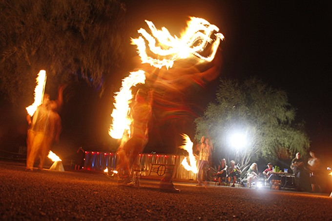 Members of the circus, dance and theater group Flam Chen dancing with fire at Rhythm Industry Performance Factory's quarterly review.