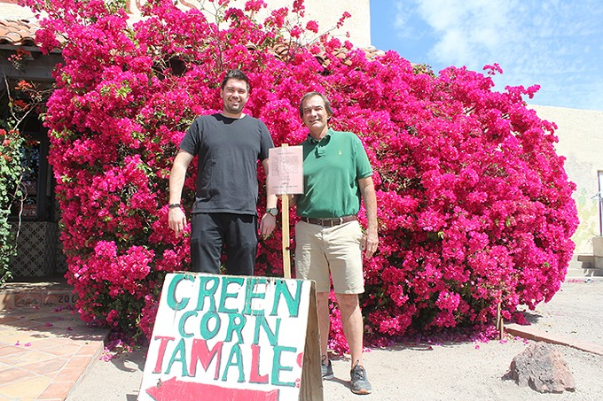 """Mike Holquist, Jr., and father Mike Sr., hold the City of Tucson sign informing Lerua's Restaurant that their property has """"been appraised and an offer made."""""""