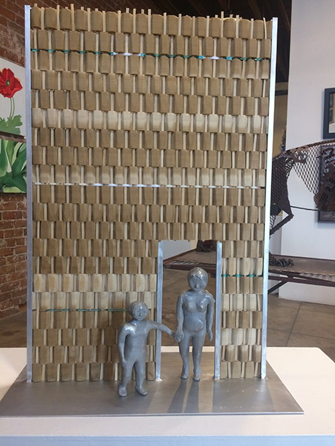 """Gateway of Courage,"" sculpture by ​Perla Segovia​, crafted from in kiln-formed glass, cotton, aluminum and poplar."