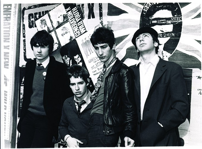 Notkin and Gaiman's punk band, Ex-Execs, in 1977. Left to right: Graham K. Smith (bass), Goeff Notkin (drums), Neil Gaiman (vocals) and Al Kingsbury (guitar).