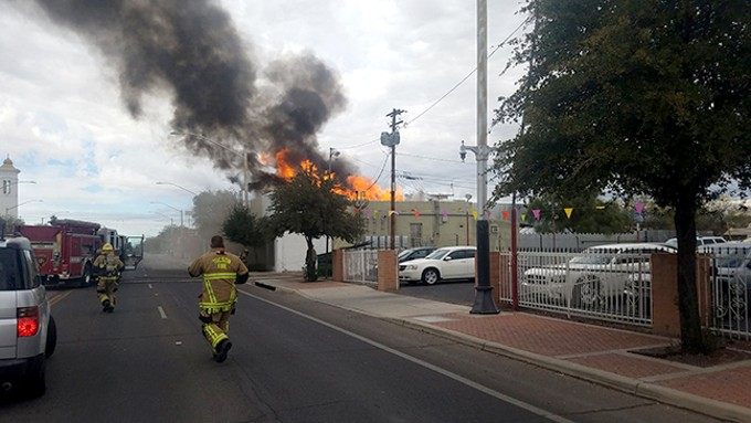 Tucson Fire Department firefighters arrive at 1319 S. Sixth Ave., where a residential fire spread to two adjacent business.