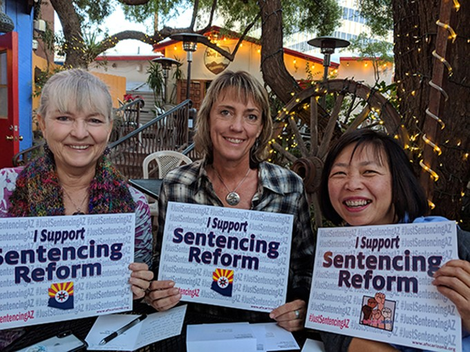 At La Cocina, friends fill out holiday greeting cards for incarcerated people in Arizona as part of the American Friends Service Committee's push for sentencing reform.