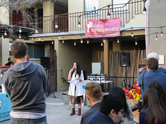 Zaira Livier, co-founder of People's Defense Initiative, addressing the crowd at the Tucson Families Free and Together campaign party.