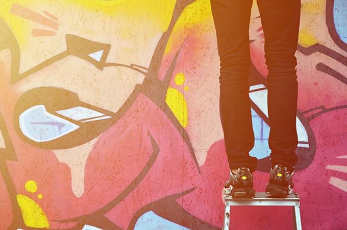bigstock-a-young-graffiti-artist-paints-277115890.jpg