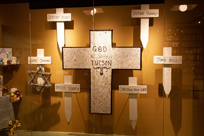 Six white crosses commemorate those who died in the shooting of Jan. 8, 2011.