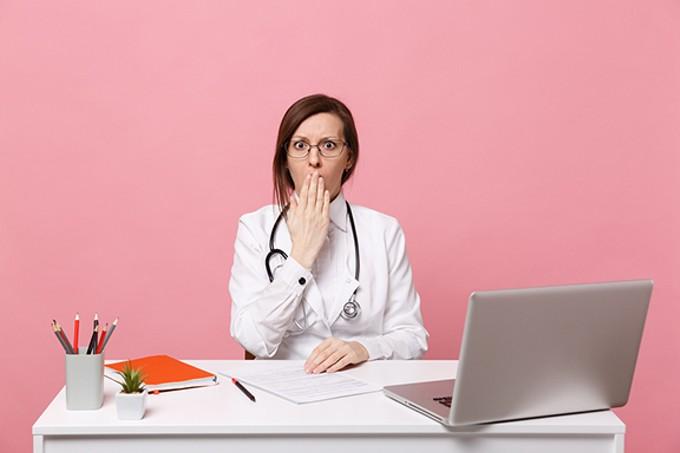 bigstock-tired-sad-female-doctor-sits-a-295727383.jpg