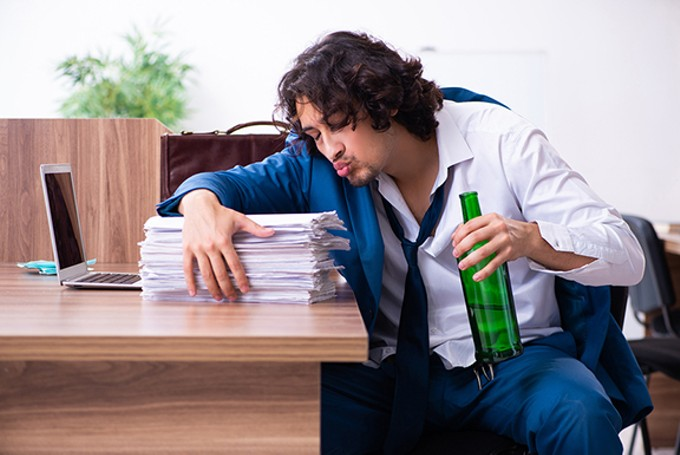 bigstock-young-drunk-employee-in-the-of-324852913.jpg