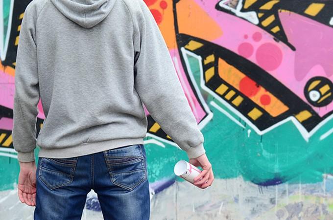 bigstock-a-young-graffiti-artist-in-a-g-246208052.jpg