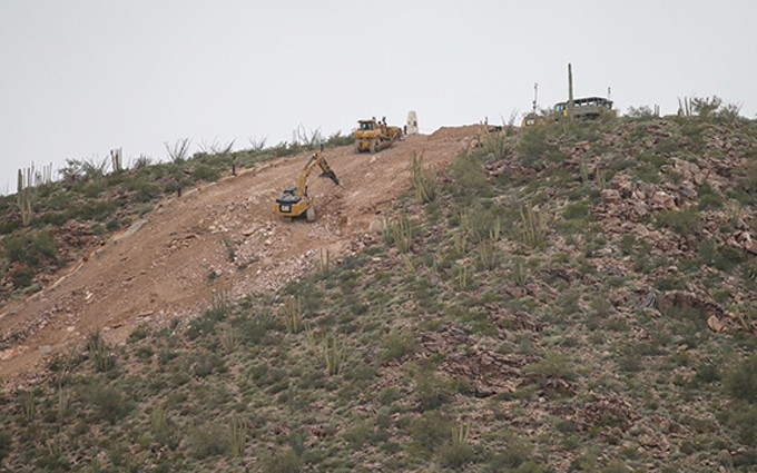 Earthmoving equipment clears a path up Monument Hill in Organ Pipe Cactus National Monument, just west of Lukeville. Advocates and Tohono O'odham Nation officials are concerned about damage to the environment, lands sacred to indigenous people and potential impact on migrating animals.