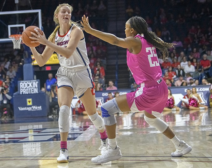 Arizona Wildcats forward Cate Reese looks to make a pass while being guarded by Tyiona Watkins at McKale Center on Friday, Feb. 14.