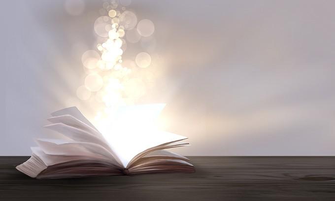 bigstock-an-open-book-with-a-magical-fa-290869114.jpg
