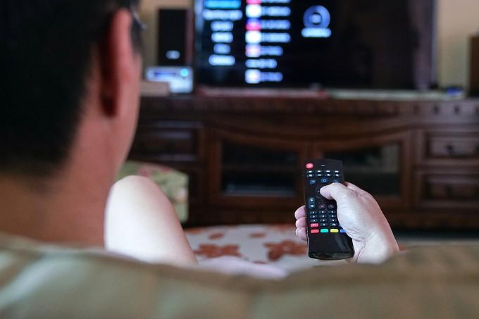 bigstock-man-watching-tv-with-focus-on--356826845.jpg