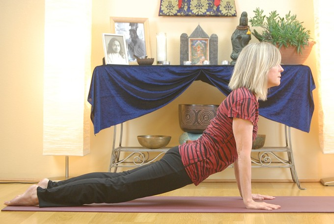 Charlotte Adams demonstrates Upward Dog during this ongoing yoga practice session.