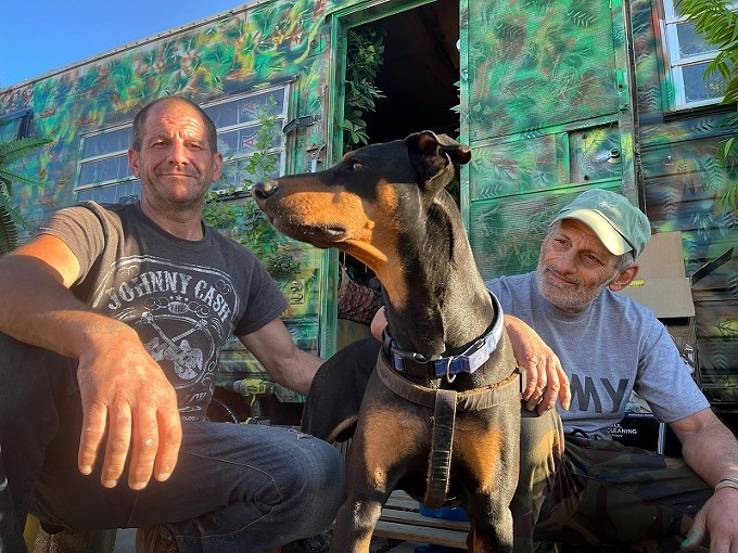 Scott Fisher (left) his pup Osso, and Frank Capanear.