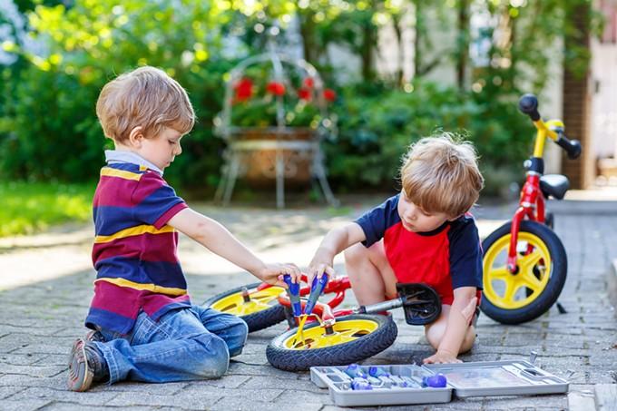 bigstock-father-teaching-two-little-kid-87120824.jpg