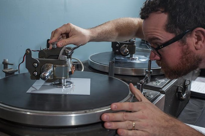 Michael Dixon makes vinyl from plexiglass.