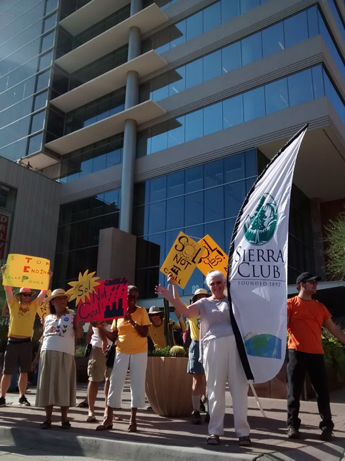 About 100 people protested TEP's net metering proposal in front of its Tucson headquarters last week.