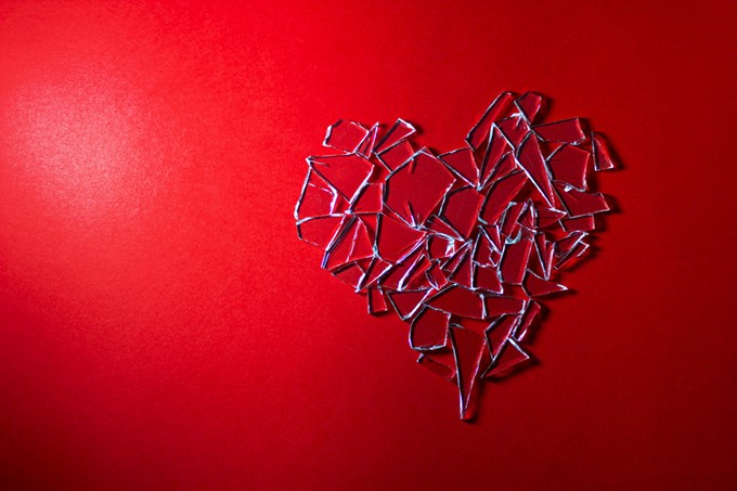 bigstock-broken-glass-heart-on-red-back-41286835.jpg
