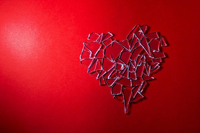 bigstock-broken-glass-heart-on-red-back-41286835.jpg