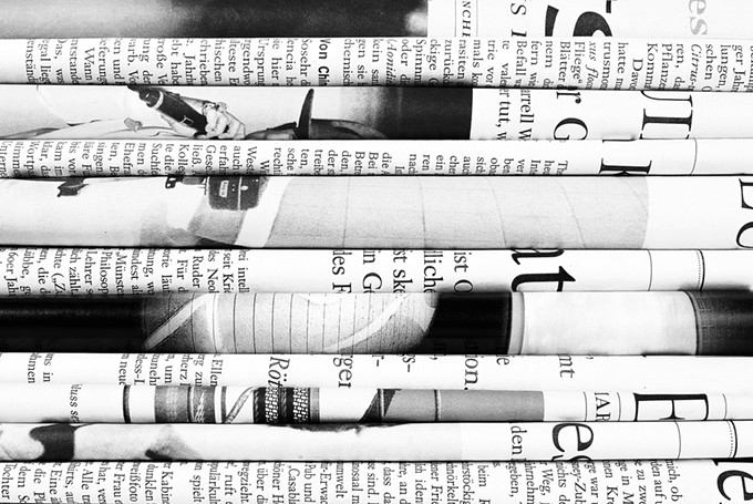 bigstock-pile-of-folded-old-newspapers-68681884.jpg