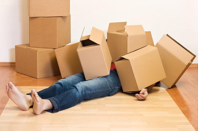 bigstock-man-covered-in-cardboard-boxes-4939694.jpg