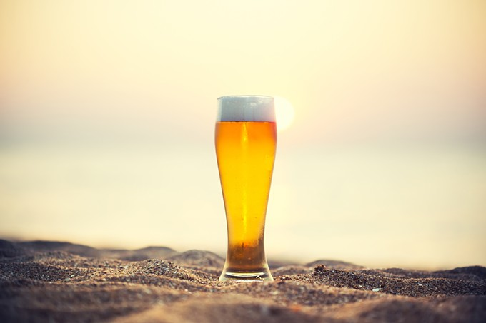 bigstock-glass-of-beer-on-a-sunset-86120447.jpg