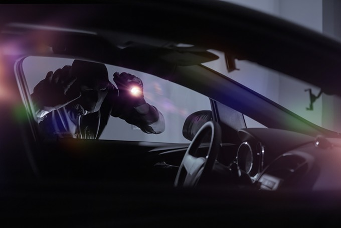 bigstock-car-robber-with-flashlight-100737350.jpg