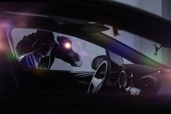 bigstock-car-robber-with-flashlight-100737350.jpg