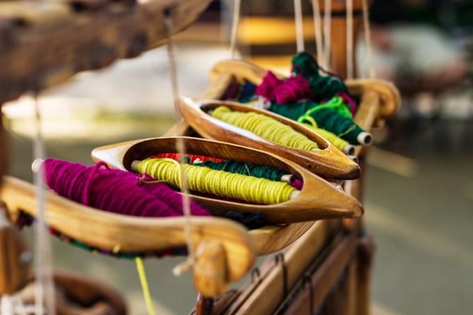 bigstock-weaving-loom-and-thread-of-yar-98353994.jpg