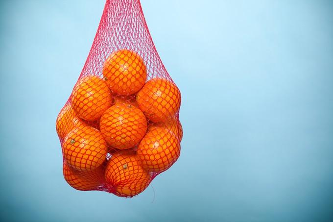 bigstock-fresh-oranges-fruits-in-mesh-f-73417171.jpg