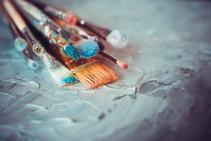 bigstock-paintbrushes-on-artist-canvas--85808675.jpg