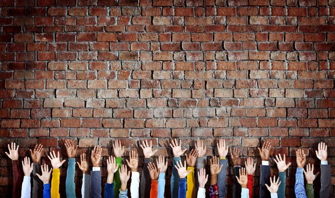 bigstock-group-of-diverse-hands-raised--82207679.jpg