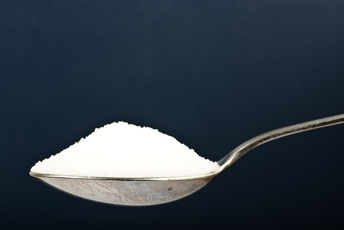 bigstock-sugar-on-spoon-on-dark-backgro-17669003.jpg