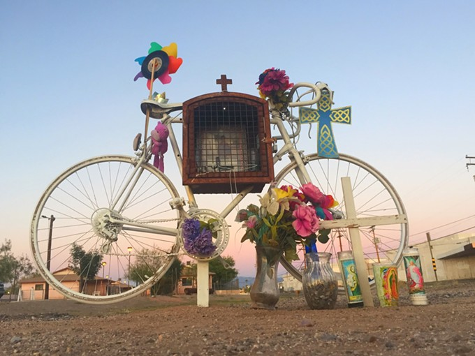 A lovely altar to a man who in 2014 was hit on his bicycle after he'd purchased bottled water at a nearby store. He was hit by a cop. The cop was never charged.