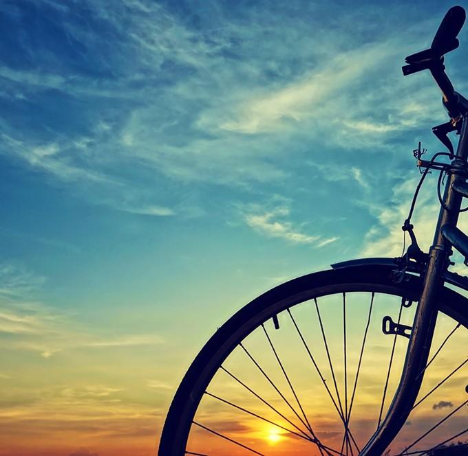 bigstock-beautiful-bike-silhouette-sun-72605608.jpg