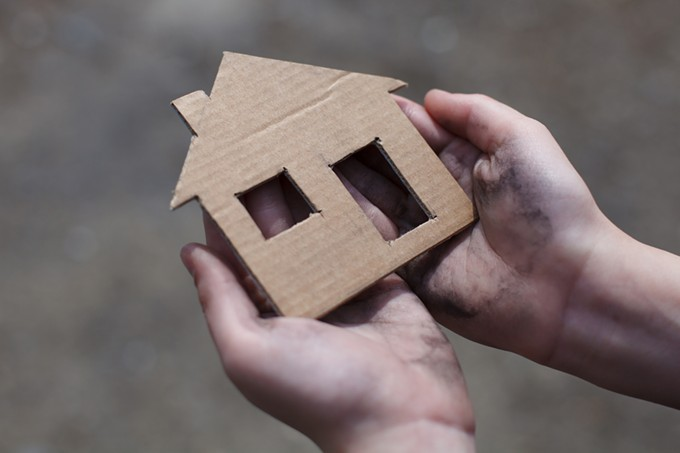bigstock-homeless-boy-holding-a-cardboa-90374690.jpg