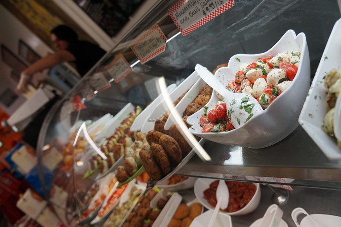 A deli counter of deliciousness at Roma Imports.