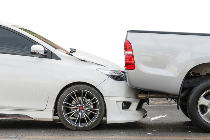 bigstock-car-accident-involving-two-car-129522731.jpg