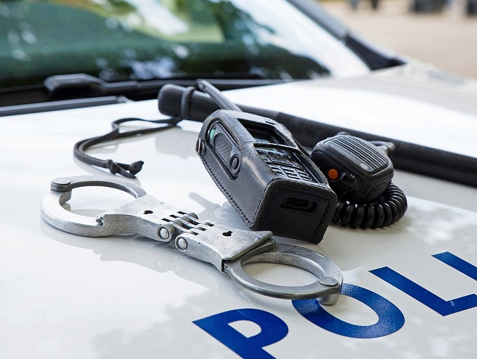 bigstock-police-equipment-on-a-police--148261448.jpg