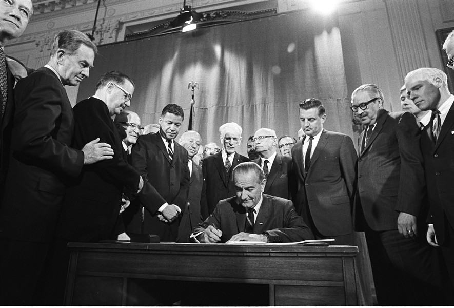 President Johnson signing Fair Housing Act into law. - COURTESY