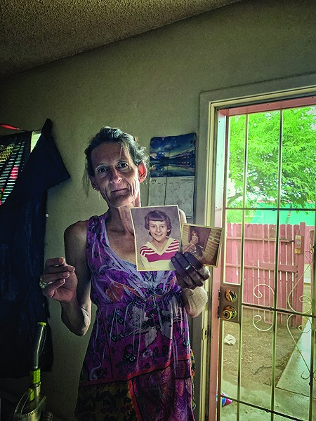 "Darlene holds photos of herself as a child. ""It was a long ago me. And it was yesterday."" - BRIAN SMITH"