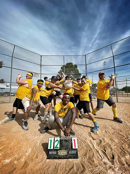 The Tucson's GayKickball yellow team. Brian Williams (front and center) and Marquez Johnson (partially hidden holding the ball). - BRIAN SMITH