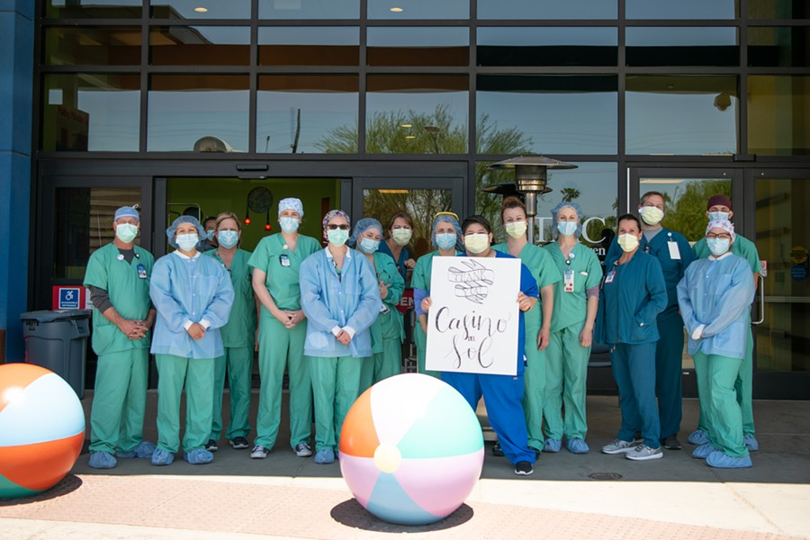 Staff holding a 'Thank You' sign at Tucson Medical Center after receiving lunch from Casino Del Sol Wednesday, April 22. - COURTESY PHOTO